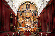 """Low angle view, interior, San Jeronimo Chapel, University of Salamanca, Salamanca, Spain, pictured on December 18, 2010. The 18th century Baroque style chapel was designed by architect Simon Garvillan Tome. Above the altar is a large painting of San Jeronimo, attributed to Simon Pitti. Salamanca, an important Spanish University city, is known as La Ciudad Dorada (""""The golden city"""") because of the unique golden colour of its Renaissance sandstone buildings. Founded in 1218 its University is still one of the most important in Spain. Around it the Old Town is a UNESCO World Heritage Site. Picture by Manuel Cohen"""