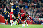 Liverpool forward Rhian Brewster (24) and Arsenal defender Shkodran Mustafi (20)  during the EFL Cup match between Liverpool and Arsenal at Anfield, Liverpool, England on 30 October 2019.