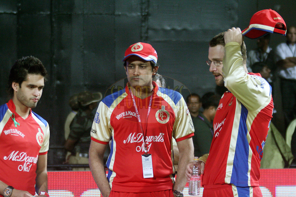 Siddarth Malaya (RCB's owner's son), Anil Kumble (coach) and Daniel Vettori (captain of RCB seen after the match 8 of the the Indian Premier League ( IPL ) Season 4 between the Royal Challengers Bangalore and the Mumbai Indians held at the Chinnaswamy Stadium, Bangalore, Karnataka, India on the 12th April 2011..Photo by Vino John/BCCI/SPORTZPICS