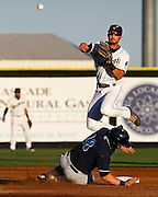 Dust Devils second baseman Kodi Tidwell leaps over Hillsboro Hops designated hitter Nate Irving to get the force out at second but wasn't able to turn the double play in the second inning of their game Thursday at Gesa Stadium in Pasco.