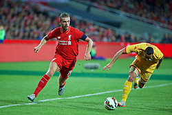 ADELAIDE, AUSTRALIA - Monday, July 20, 2015: Liverpool's captain Jordan Henderson in action against Adelaide United's Tarek Elrich during a preseason friendly match at the Adelaide Oval on day eight of the club's preseason tour. (Pic by David Rawcliffe/Propaganda)