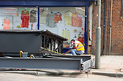 © London News Pictures. 12/05/15. London, UK. A woman has been rushed to hospital after she was crushed when a large advertising billboard fell from a wall in Tooting South London today 12th May 2015. Photo credit: Laura Lean/LNP