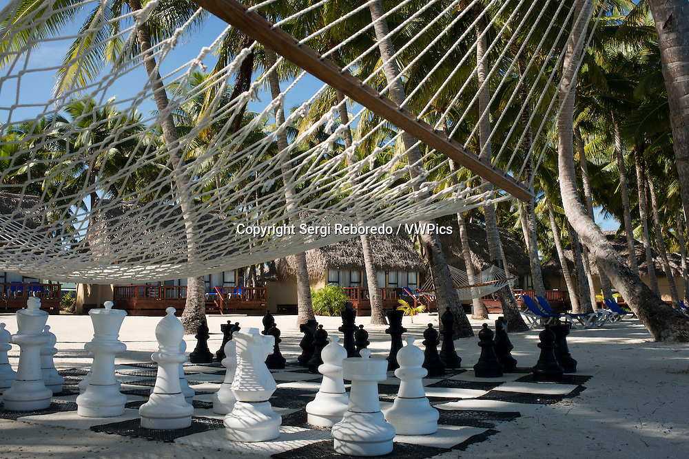 Aitutaki. Cook Island. Polynesia. South Pacific Ocean. Giant chess set on the beach of the Aitutaki Lagoon Resort & Spa Hotel. With a lagoon that is arguably one of the most beautiful in the world, a cruise out on its pristine water is an absolute must. You are likely to be so enchanted, that you'll book another tour for the next day. Back on land, the island of Aitutaki has an interesting history and there are excavations of local marae underway. You can take a safari tour to these ancient places, explore the island and also find out about the legacy of the American troops stationed here during WWII. For novice scooter riders, Aitutaki is generally safer than Rarotonga where traffic can be quite busy at times. (There are also no dogs.) There are not many shops but there is also some locally made handcraft for sale. And when it comes to the nightlife, well these guys know how to party! Aitutaki also has world class restaurants, some fun casual places to meet up with locals and Island Nights. Aitutakians are known as some of the best dancers in the Cook Islands - which is an impressive reputation in this country of dancers. Their agility, rhythm and grace are often recognised in the national dance competitions. Aitutakians are also acknowledged to be excellent drummers. Now they are extending their repertoire to include dancing with fire. It all makes for stunning showmanship by these modern Pacific warriors. It also makes the Island and Cultural Night a special event on Aitutaki. There are shows on most nights of the week at different resorts and venues. Island Nights usually include a buffet feast featuring local and international dishes, or an a la carte menu. You need to make reservations for an Island Night.