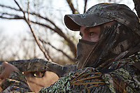 TURKEY HUNTER WEARING REALTREE MAX-1 CAMO WAITING FOR TURKEYS TO APPEAR
