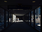 """13 MARCH 2020 - DES MOINES, IOWA: People in an empty skywalk in downtown Des Moines. Downtown Des Moines is nearly deserted as many of employers are implementing work at home rules. The Governor of Iowa announced Friday that 17 people in Iowa have tested positive for the Novel Coronavirus. Of those, 15 people were exposed on the same cruise in Egypt, the others were exposed through travel but were not on the same cruise. The Governor said there has not yet been any """"community spread"""" in Iowa. All of the Iowans who have tested positive are in self quarantine. Across Iowa, municipalities and businesses are taking steps to implement """"social distancing."""" Most of the colleges in Iowa have announced that they will remain closed after their spring breaks and that classes will move to online only, after spring break. Many businesses in Des Moines, including Nationwide Insurance and EMC Insurance, have announced plans to have their employees to telecommute. The mayor of Des Moines has urged event planners to consider canceling large events.     PHOTO BY JACK KURTZ"""