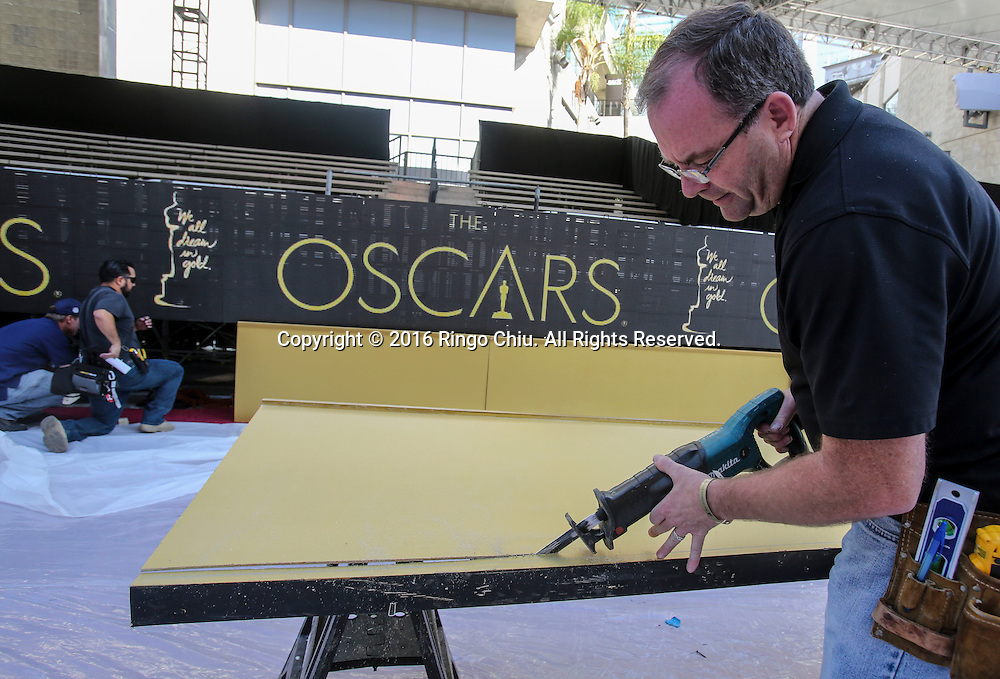 A worker  sets up for the Oscars in front of the Dolby Theatre Feb. 25, 2016 in Los Angeles. The 88th Academy Awards will be held Sunday, February 28, 2016. (Photo by Ringo Chiu/PHOTOFORMULA.com)<br /> <br /> Usage Notes: This content is intended for editorial use only. For other uses, additional clearances may be required.