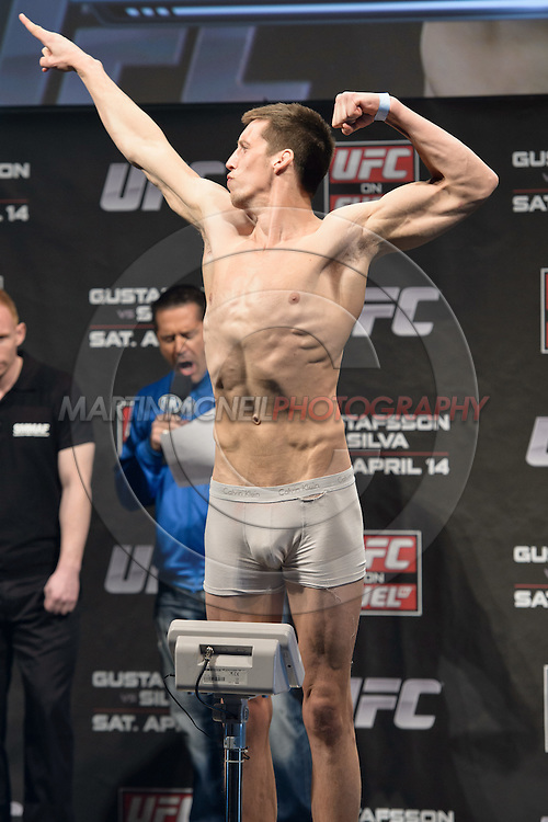 "STOCKHOLM, SWEDEN, APRIL 13, 2012: Magnus Cedenbland stands on the scales at the weigh-in for ""UFC on Fuel TV: Gustafsson vs. Silva"" inside the Ericsson Globe Arena, Stockholm."
