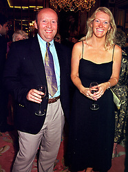 MR & MRS MICHAEL BOOTH, he is a QC., at a party in London on 2nd September 1999.MUW 26