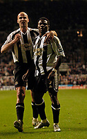 Photo: Jed Wee.<br /> Newcastle United v Reading. The Barclays Premiership. 06/12/2006.<br /> <br /> Newcastle's first goalscorer Antoine Sibierski (L) celebrates with scorer of their second goal, Obafemi Martins.