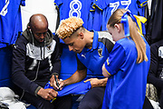 AFC Wimbledon Forward Lyle Taylor (33) meets the match day mascot ahead of the EFL Sky Bet League 1 match between AFC Wimbledon and Fleetwood Town at the Cherry Red Records Stadium, Kingston, England on 30 March 2018. Picture by Stephen Wright.