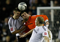 Photo: Steve Bond/Richard Lane Photography. Derby County v Blackpool. Coca-Cola Championship. 26/12/2009. Jake Buxton (L) gets his head to the ball above Ben Burgess (C). Jay McEveley (R) looks back