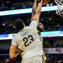 Mar 11, 2018; New Orleans, LA, USA; New Orleans Pelicans forward Anthony Davis (23) blocks a dunk attempt by Utah Jazz forward Royce O'Neale (23) during the second half at the Smoothie King Center. Mandatory Credit: Derick E. Hingle-USA TODAY Sports