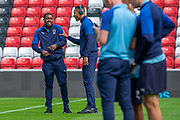 Paul Kalambayi (#30) and Terell Thomas (#6) of AFC Wimbledon share a joke before the EFL Sky Bet League 1 match between Sunderland and AFC Wimbledon at the Stadium Of Light, Sunderland, England on 24 August 2019.