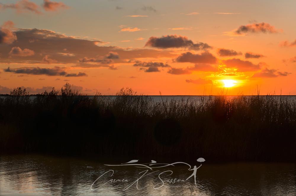 The sun sets over Heron Bay at Cedar Point, Ala. Sept. 7, 2012. (Photo by Carmen K. Sisson/Cloudybright)