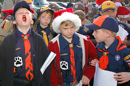 H:\EDITORIAL\Photos\12 December 2009\JH 12-17-09  BIG YAWNóVentura County Boy Scouts of America Council Troop 3604 cub Alex Edwards, 6, a Pinecrest School first-grade student,  left, lets out a mighty big yawn to the surprise of cub Sean Mosher, right, and dismay of cub Nick Sweet, center, before the start of the troops' caroling at Moorpark Presbyterian Church on Sunday, December 13, in Moorpark.