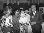 Vietnamese Refugees are Naturalised.  (R61)..1987..08.07.1987..07.08.1987..8th July 1987..A large group of Vietnamese refugees were presented with certificates of naturalisation by Justice Minister, Gerard CollinsTD at the dept of Foreign Affairs in Iveagh House today. The vietnamese were dispossed due to the Vietnam war.The group ,consisting of 156 adults, arrived in Ireland from Vietnam and some refugee camps inHong Kong and Malaysia...Image shows Trieu Trien Minh, his wife and daughter Christina (2) with Minister Gerard Collins and a government official after the family had recieved their naturalisation certificates.