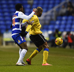 Reading's Nathaniel Chalobah challenges Wigan Athletic's Leon Clarke - Photo mandatory by-line: Paul Knight/JMP - Mobile: 07966 386802 - 17/02/2015 - SPORT - Football - Reading - Madejski Stadium - Reading v Wigan Athletic - Sky Bet Championship