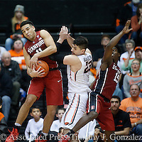 Stanford's Dorian Pickens, left, grabs a rebound away from Oregon State's Gligorije Rakocevic, center, and teammate Marcus Allen, right, during the second half of an NCAA college basketball game in Corvallis, Ore., Thursday, Jan. 19, 2017. Stanford won 62-46. (AP Photo/Timothy J. Gonzalez)