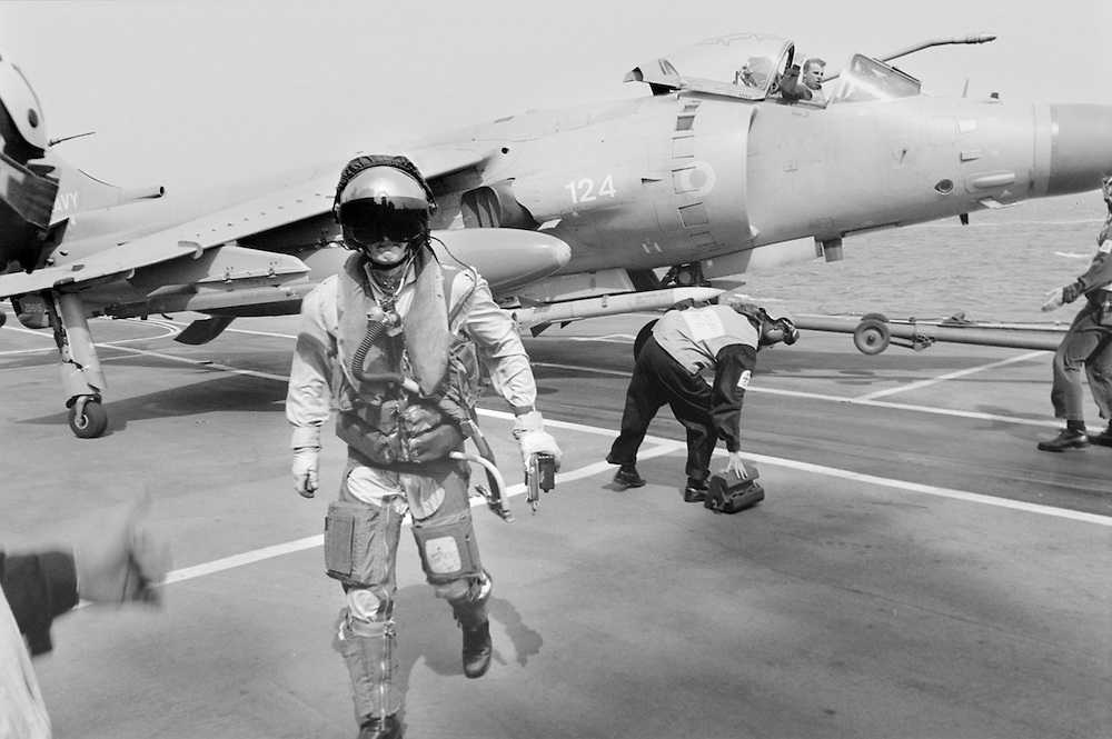 A Harrier pilot from 800 squadron steps down from his aircraft. Harriers act as fighter escorts -  including American Tomcats and Hornets from the U.S.S. Carl Vincent - in sorties enforcing the southern no-fly zone over Iraq . Violations both North and South no-fly zone topped 100 in during January and Feb 1999 by Neville Elder