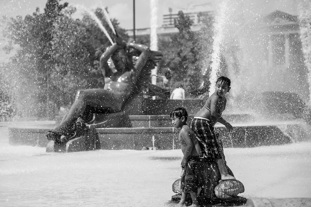 Boys cool off in the fountain at Logan Square.