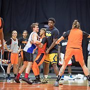 UNCASVILLE, CONNECTICUT- May 2:  Courtney Williams #10 of the Connecticut Sun is trapped while playing against men during the Connecticut Sun pre season training in preparation for the 2018 WNBA season at Mohegan Sun Arena on May 2, 2018 in Uncasville, Connecticut. (Photo by Tim Clayton/Corbis via Getty Images)