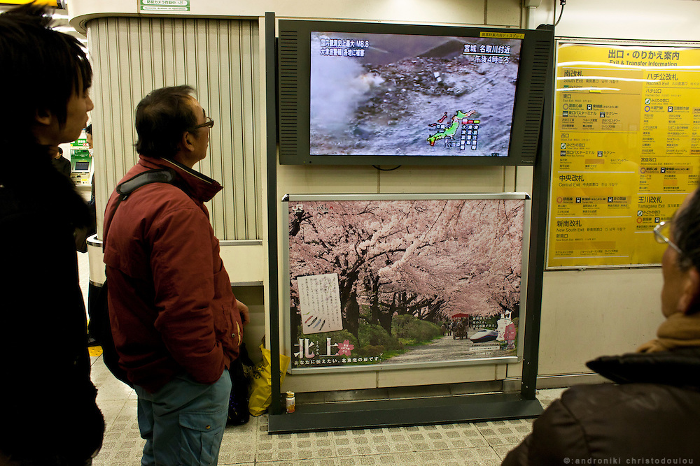 People watching the news on a TV monitor at Shibuya station, about the distraction that the earthquake that hit Tokyo around 15:00 on Friday the 11th of March caused.