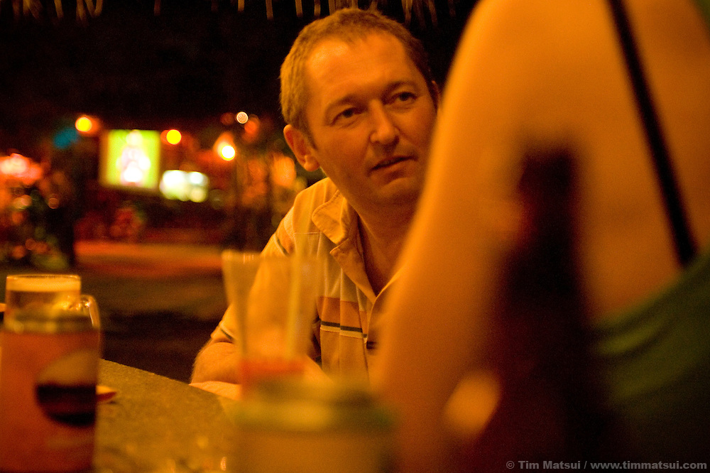 A Scottish tourist describes why he came to Sihanoukville, Cambodia, while seated at the Corner Bar on Victory Hill He said he'd come for &quot;drinking, drugs, fucking,&quot; then proceeded to quote prices and instances.<br /> &quot;Don't pay more than $8 dollars, $10 max,&quot; he advised. I nodded and smiled. &quot;I got a girl, fucking gorgeous. $10 dollars. Had to give her a dollar for the moto home the next morning. I totally abused her. I woke up in the night and said 'suck!' just to see if I could,&quot; the man said.<br /> <br /> Read more: http://timmatsui.com/blog/2008/02/01/cambodia-the-sex-tourist/