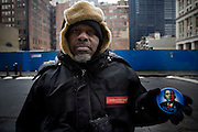 20th January 2009, the inauguration of President Obama.  Ground Zero, Downtown New York City..People selling badges and photos of the new President of the United States of America...Image © Arsineh Houspian/Falcon Photo Agency
