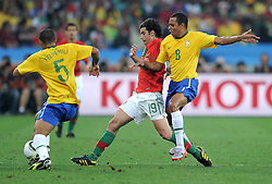 FELIPE MELO , TIAGO and  GILBERTO SILVA in action during the 2010 FIFA World Cup South Africa Group G match between Portugal and Brazil at Durban Stadium on June 25, 2010 in Durban, South Africa.