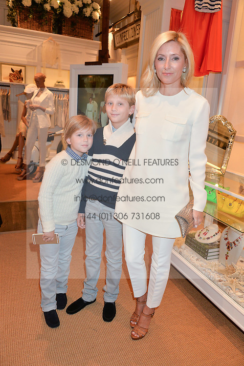 PRINCESS MARIE-CHANTAL OF GREECE with her sons PRINCE ARISTIDIS-STAVROS OF GREECE and PRINCE ODYSSEUS-KIMON OF GREECE  at a party to celebrate the publication of India Hicks: Island Style hosted by Princess Marie-Chantal of Greece, Saffron Aldridge and Amanda Brooks has held at Ralph Lauren, 105-109 Fulham Road, London on 28th April 2015,