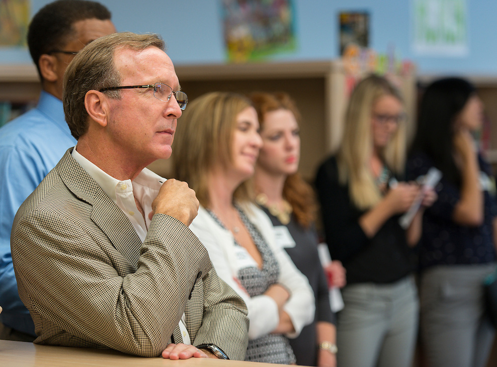 Neil Bush listens to comments during a news conference discussing back to school parenting at Cunningham Elementary School, September 3, 2015.