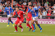 York City forward, on loan from Oldham Athletic, Rhys Turner and Carlisle United midfielder Gary Dicker during the Sky Bet League 2 match between York City and Carlisle United at Bootham Crescent, York, England on 19 September 2015. Photo by Simon Davies.