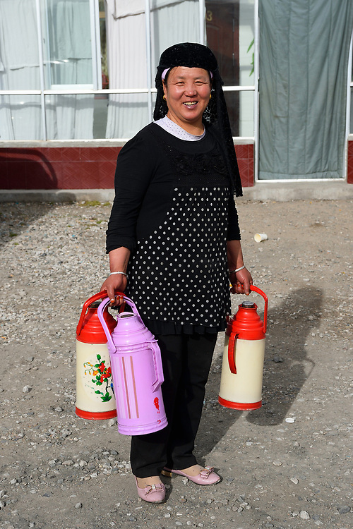 Tibetans in Wenquan, our landlady with thermoses, Tibetan Plateau, Qinghai, China