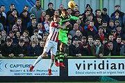 Forest Green Rovers Dale Bennett(2) and Cheltenham Town's Carl Winchester(11) challenge for the ball during the EFL Sky Bet League 2 match between Forest Green Rovers and Cheltenham Town at the New Lawn, Forest Green, United Kingdom on 25 November 2017. Photo by Shane Healey.