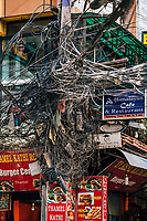 Tangles of wires and restaurant signs in the Thamel district of Kathmandu.