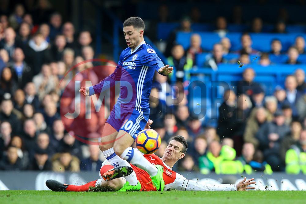 Laurent Koscielny of Arsenal sliding tackle on Eden Hazard of Chelsea - Mandatory by-line: Jason Brown/JMP - 04/01/2017 - FOOTBALL - Stamford Bridge - London, England - Chelsea v Arsenal - Premier League