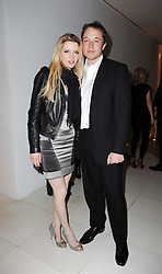 Talulah Riley and ELON MUSK at a party to celebrate Lancome's 10th anniversary of sponsorship of the BAFTA's in association with Harper's Bazaar magazine held at St.Martin's Lane Hotel, London on 19th February 2010.