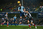 Blackpool forward Mark Cullen (9) with a header goal wards during the EFL Sky Bet League 2 match between Grimsby Town FC and Blackpool at Blundell Park, Grimsby, United Kingdom on 31 December 2016. Photo by Simon Davies.