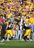18 OCTOBER 2008: Iowa quarterback Dustin Sherer (18) throws a pass over Iowa defensive lineman Mitch King (47) and Iowa defensive end Christian Ballard (46) in the first half of an NCAA college football game against Wisconsin, at Kinnick Stadium in Iowa City, Iowa on Saturday Oct. 18, 2008. Iowa won 38-16.