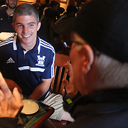 UNCW Soccer player Michael Parrish talks with his father David Parrish Saturday November 2, 2013 at Carrabba's Italian Grill. David has not seen his son play soccer since a paralyzing accident in 2011 and is in town for the last two home games of Michael's college career. (Jason A. Frizzelle)