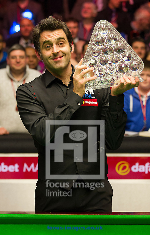 Picture by Paul Terry/Focus Images Ltd +44 7545 642257<br /> 19/01/2014<br /> Ronnie O'Sullivan lifts the trophy after winning The Masters final at Alexandra Palace, London.