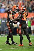 Cleveland Browns linebacker Joe Schobert (53) celebrates with Cleveland Browns defensive back T.J. Carrie (38) after intercepting a late fourth quarter pass at the New York Jets 43 yard line during the 2018 NFL regular season week 3 football game against the New York Jets on Thursday, Sept. 20, 2018 in Cleveland. The Browns won the game 21-17. (©Paul Anthony Spinelli)