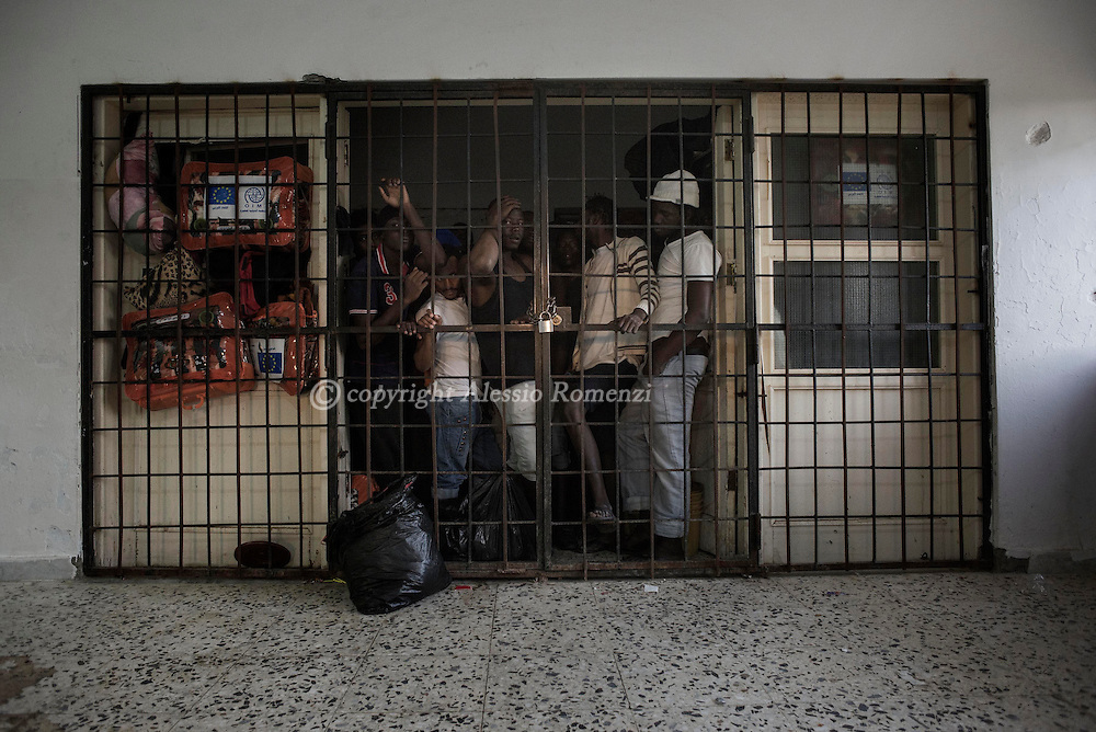 Libya, Misurata district: migrants captured at the sea as they were attempting to reach Italy are seen inside an overcrowded cell at Al Kararem detention center on May 16, 2015. Alessio Romenzi