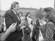 An Taoiseach Meets The Roses Of Tralee.  (N90)..1981..28.08.1981..08.28.1981..28th August 1981..An Taoiseach, Garret Fitzgerald, met with the contestants of The Rose Of Tralee Festival when they were invited to Government Buildings, Leinster House, Dublin...An Taoiseach, Garret Fitzgerald, is pictured sharing a joke with Cork Rose, Nuala O'Sullivan at the reception in Government Buildings.