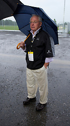 ALTACH, AUSTRIA - Saturday, July 17, 2010: Liverpool's co-owner George N. Gillett Jr. under an umbrella after a lucrative televised match against Al-Hilal Al Saudi FC, the Reds' first preseason match of the 2010/2011 season, had to be called off due to torrential rain and a waterlogged pitch at the Cashpoint Arena. (Pic by David Rawcliffe/Propaganda)
