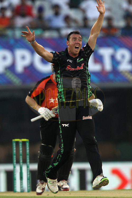 Kyle ABBOTT of the Dolphins  appeals for the wicket of  Adam VOGES (Captain) of the Perth Scorchers  during match 4 of the Oppo Champions League Twenty20 between the Dolphins and the Perth Scorchers held at the Punjab Cricket Association Stadium, Mohali, India on the 20th September 2014<br /> <br /> Photo by:  Ron Gaunt / Sportzpics/ CLT20<br /> <br /> <br /> Image use is subject to the terms and conditions as laid out by the BCCI/ CLT20.  The terms and conditions can be downloaded here:<br /> <br /> http://sportzpics.photoshelter.com/gallery/CLT20-Image-Terms-and-Conditions-2014/G0000IfNJn535VPU/C0000QhhKadWcjYs
