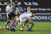 Scott Spedding of ASM Clermont Auvergne hands off Dan Biggar of Ospreys during the European Rugby Challenge Cup match between Ospreys and ASM Clermont Auvergne at The Liberty Stadium, Swansea on 15 October 2017. Photo by Andrew Lewis.