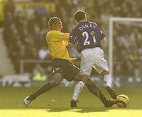 Photo: Aidan Ellis.<br /> Everton v Arsenal. The Barclays Premiership. 21/01/2006.<br /> Arsenal's Gilberto challenges Everton's Leon Osman