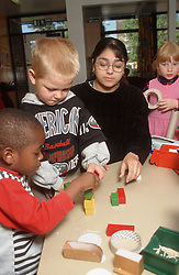 Nursery school children and teacher,
