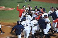 Mississippi players celebrate Austin Anderson's three run walkoff home run in the 13th inning against Auburn at Oxford-University Stadium in Oxford, Miss. on Friday, April 4, 2014. Mississippi won 8-5. (AP Photo/Oxford Eagle, Bruce Newman)
